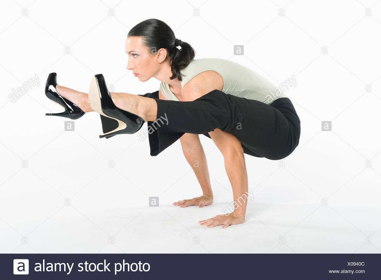 Woman with high heels exercising - Stock Image