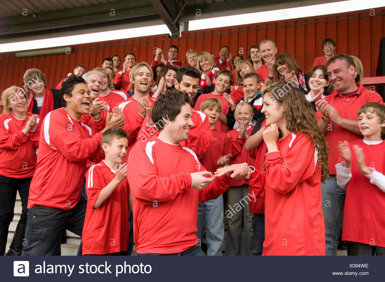 Marriage proposal at football match Stock Photo: 275567306