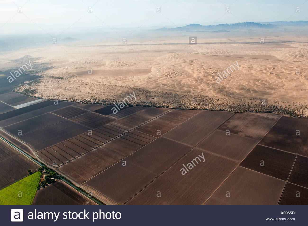 Agricultural fields meet sandy desert along the US/Mexico border. - Stock Image