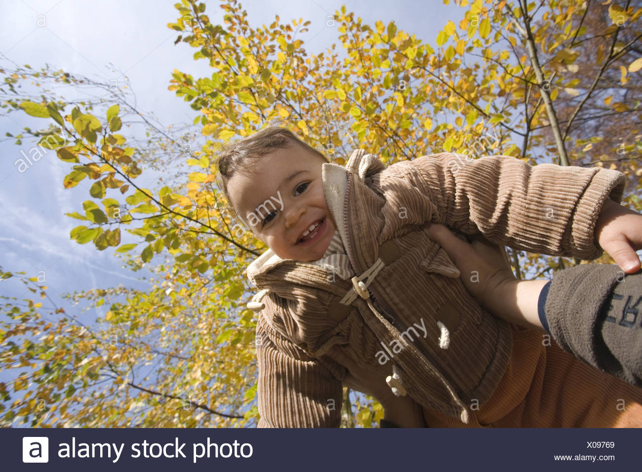 Child lifted up, Muenchen, Bavaria, Germany - Stock Image