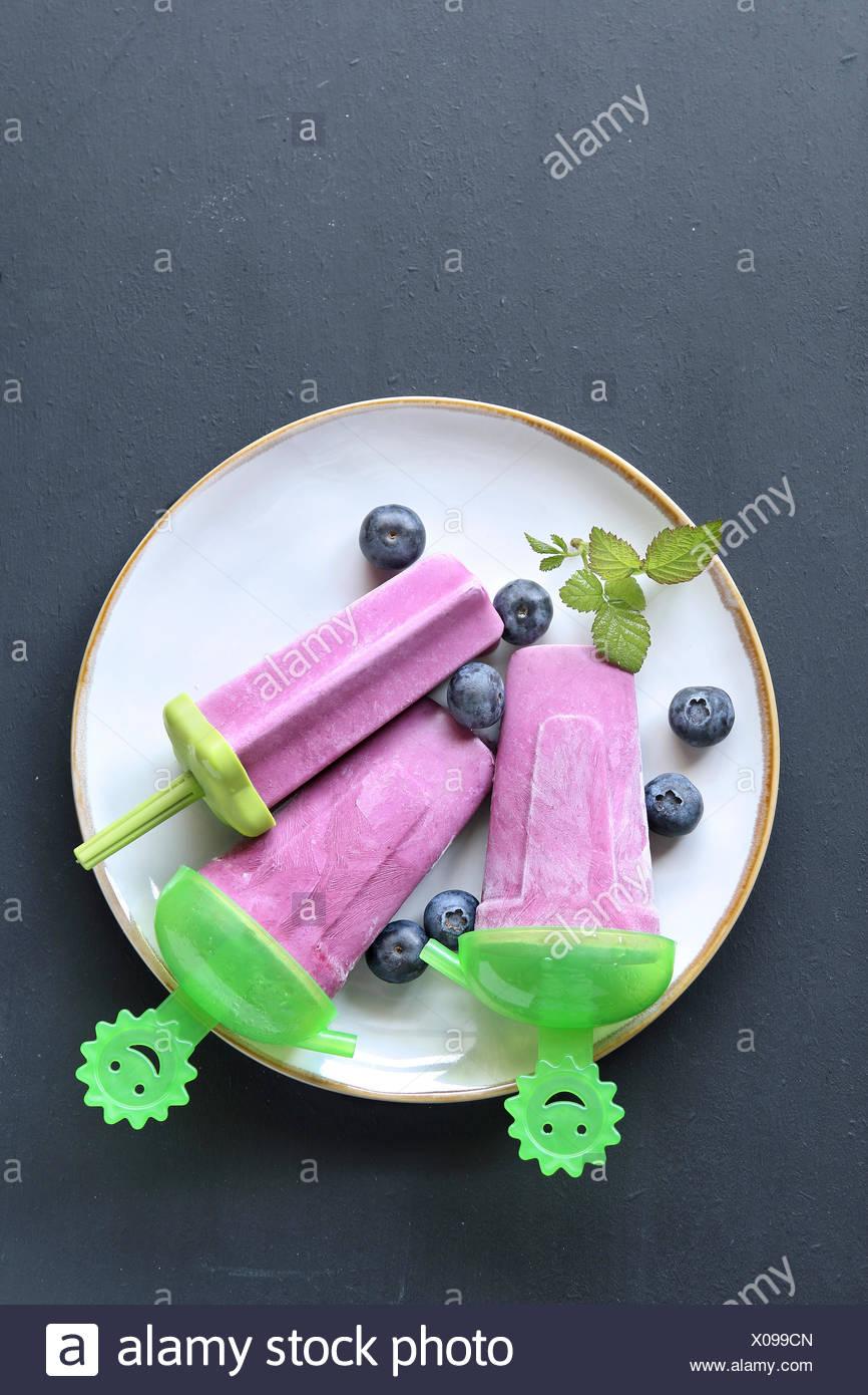Blueberry popsicle ice lollipop - Stock Image