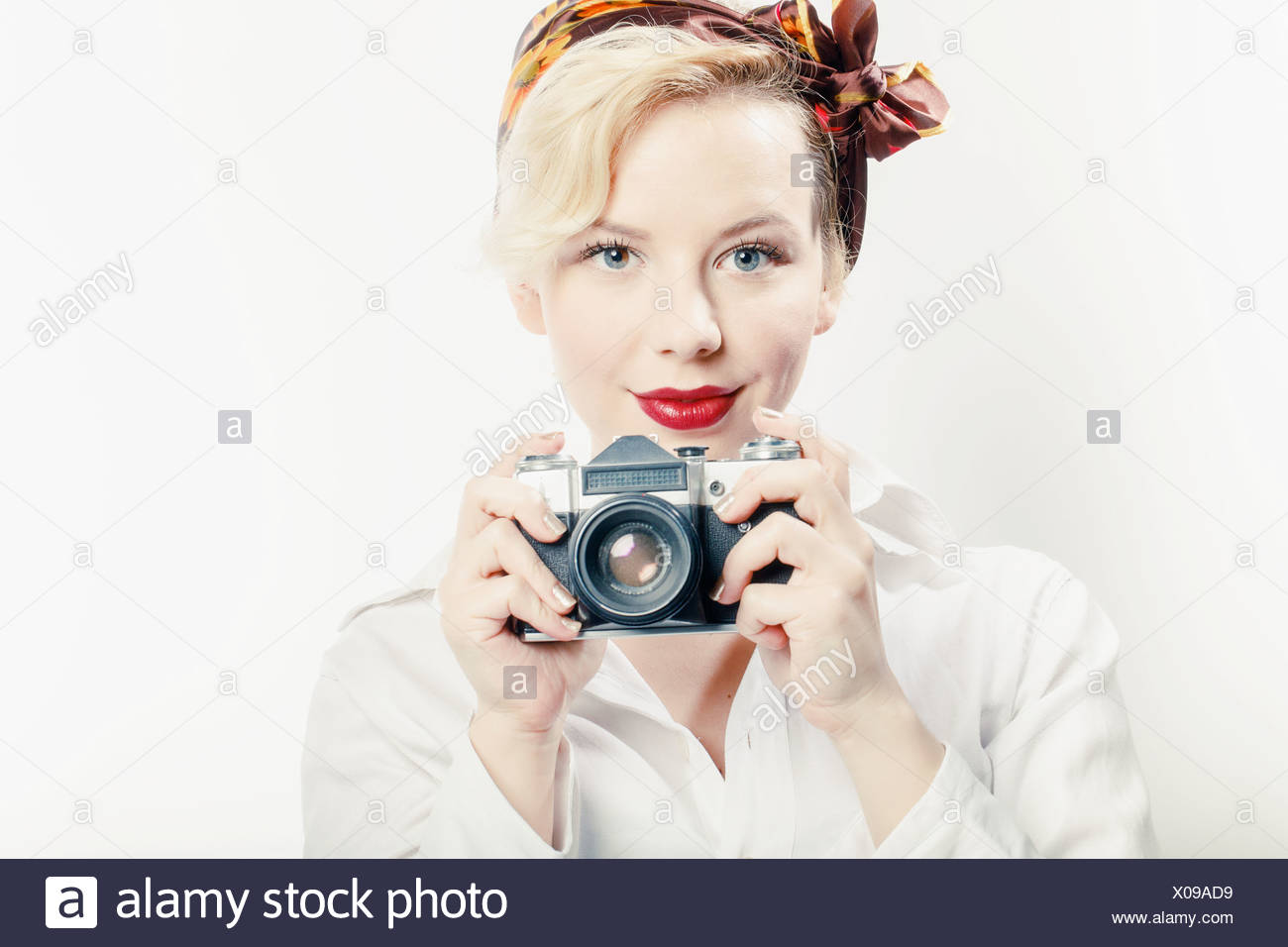 Young Woman Using Photo Camera, Portrait - Stock Image