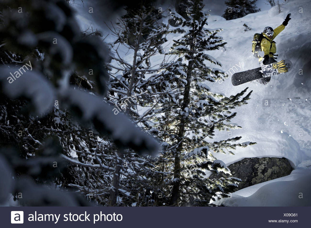 Snowboarder jumping, Chandolin, Anniviers, Valais, Switzerland - Stock Image