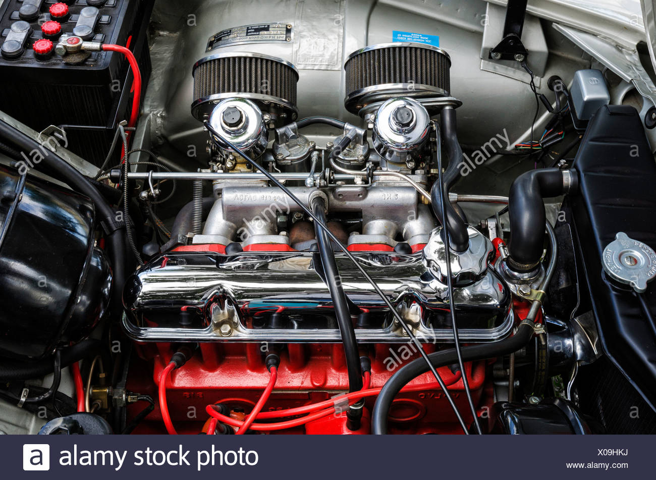 View of the engine compartment of a Volvo P1800S Pressed Steel, built in 1964, festival of classic cars 'Retro Classics meets - Stock Image