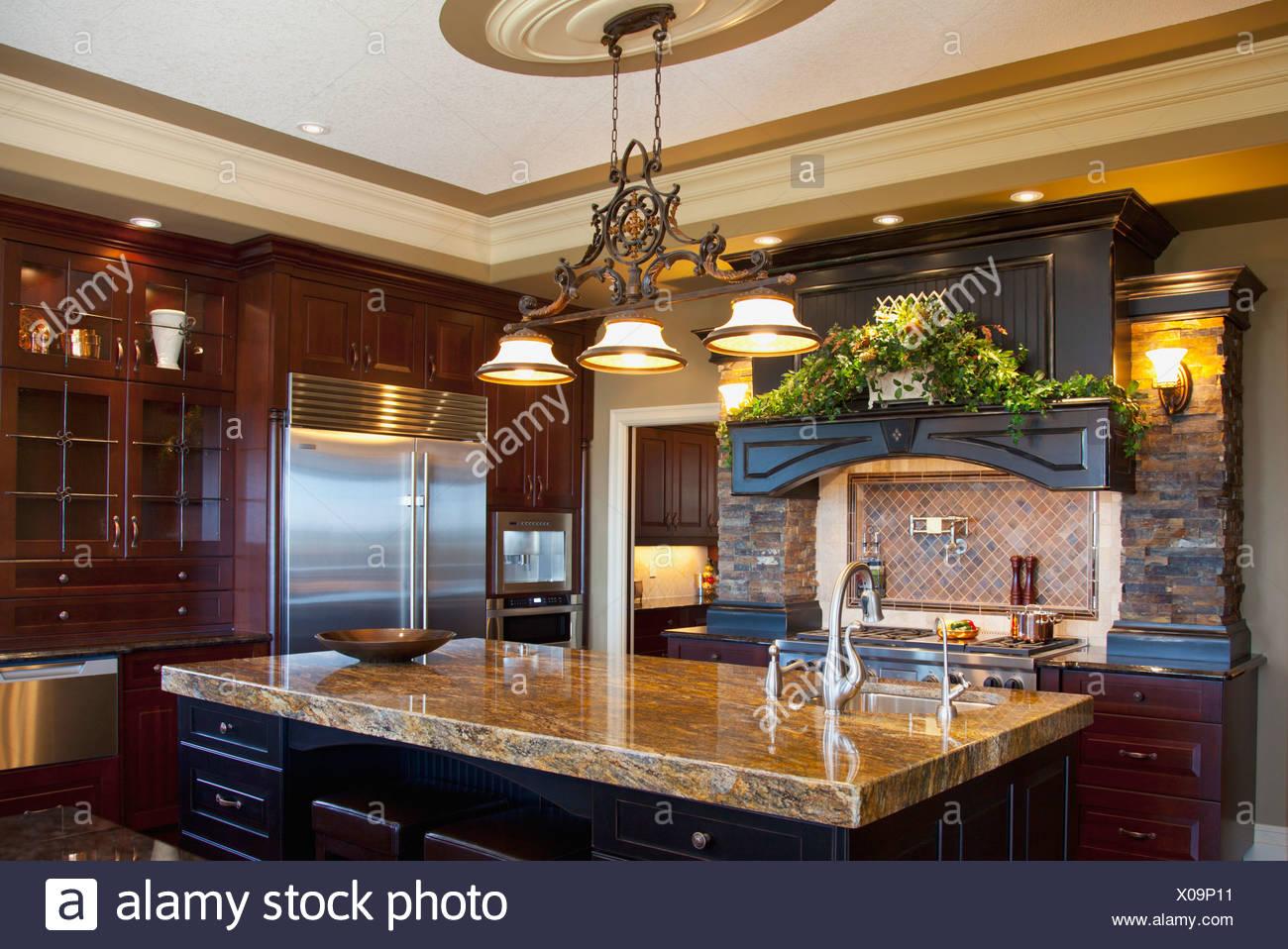 Granite Countertop Of Kitchen In Luxurious Show Home St Albert