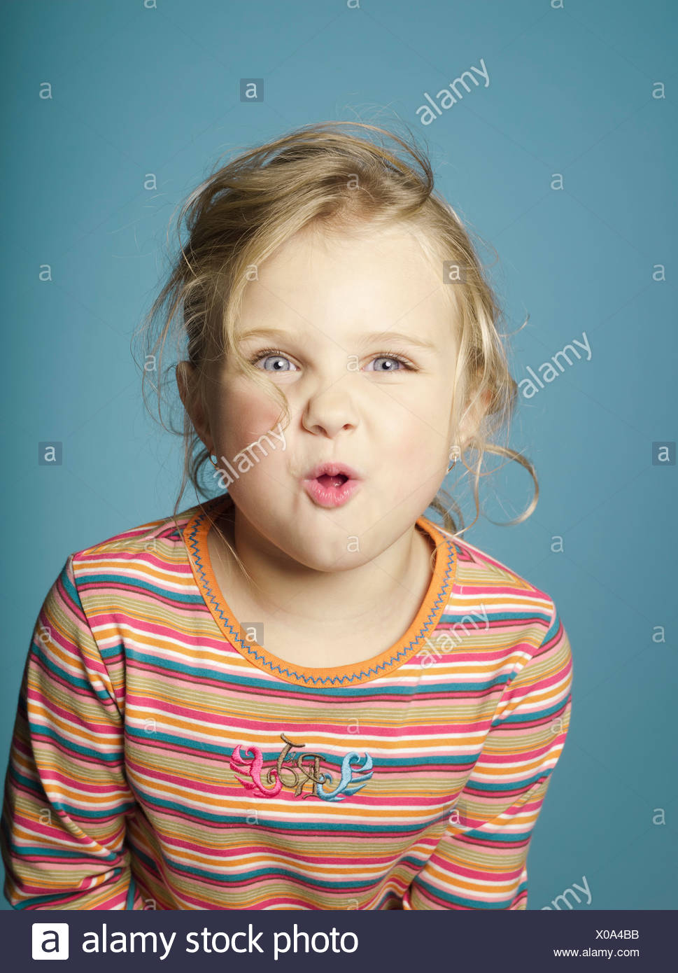 Portrait of little girl making a face - Stock Image