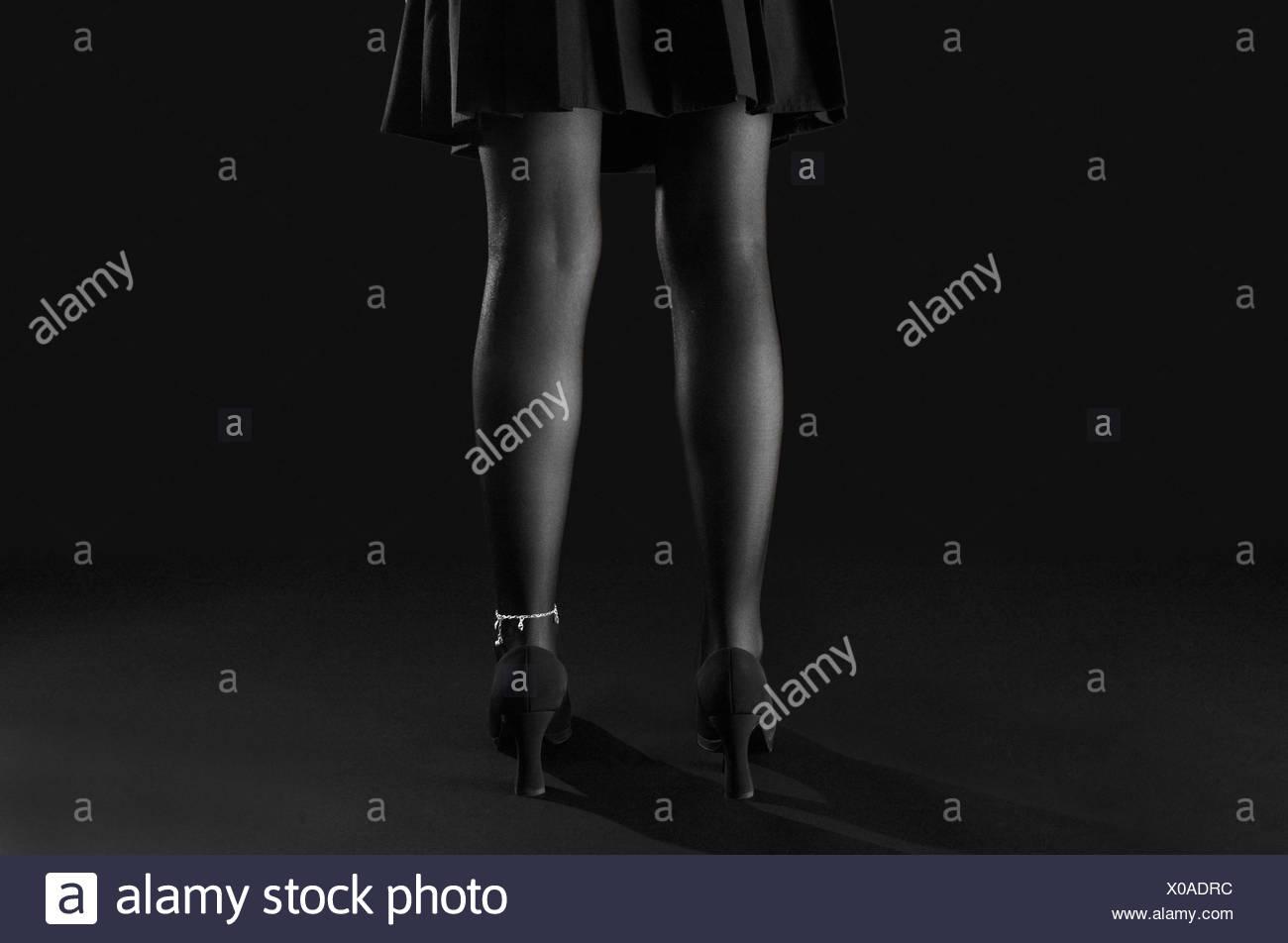 legs bw black swarthy jetblack deep black shoes chain stocking stockings leg - Stock Image