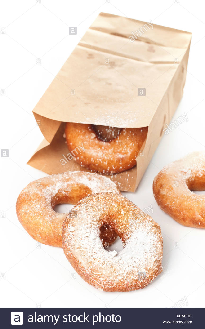 Sweet donuts with powder on white background - Stock Image