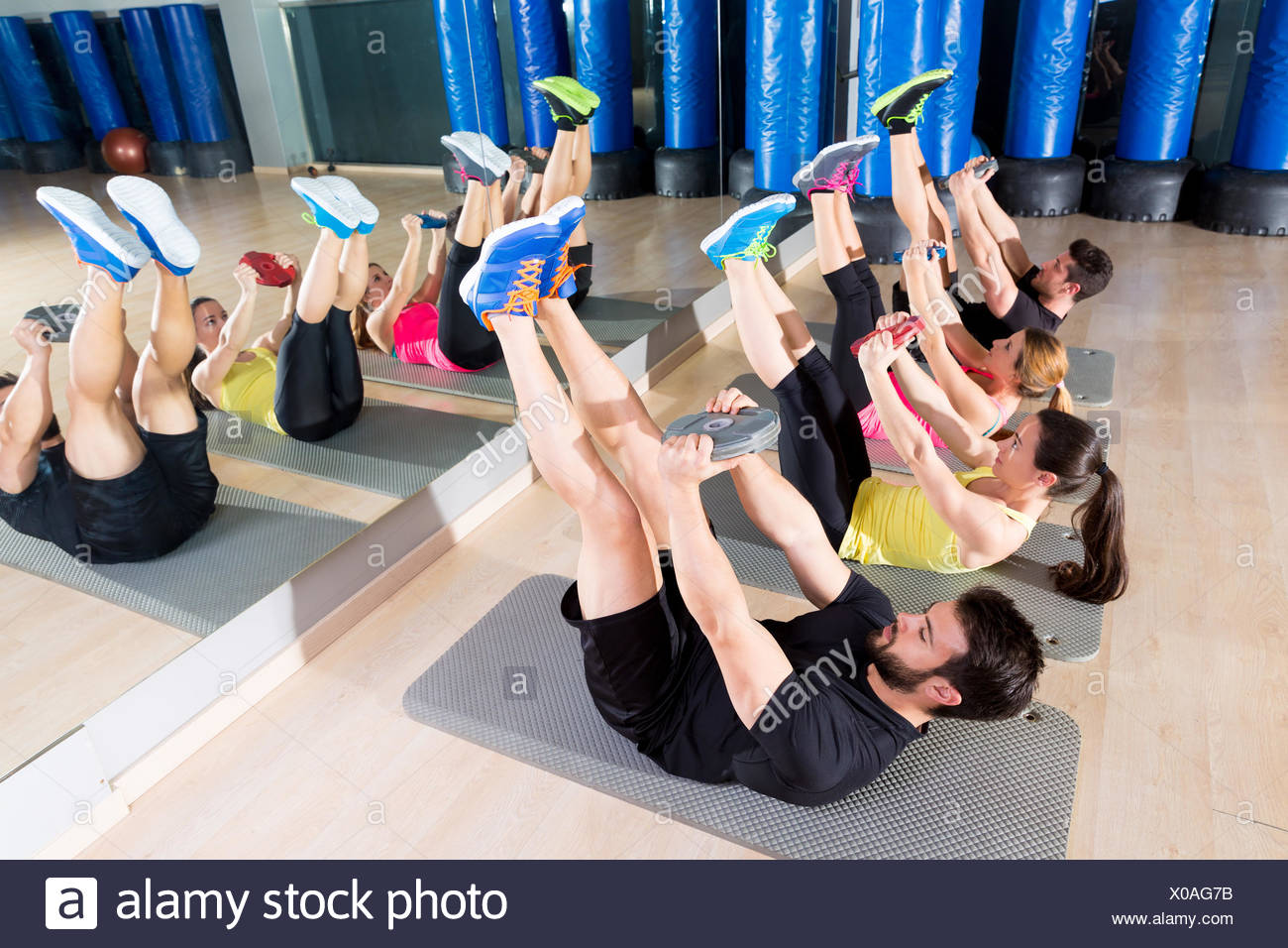 Abdominal plate training core group at gym fitness workout. - Stock Image