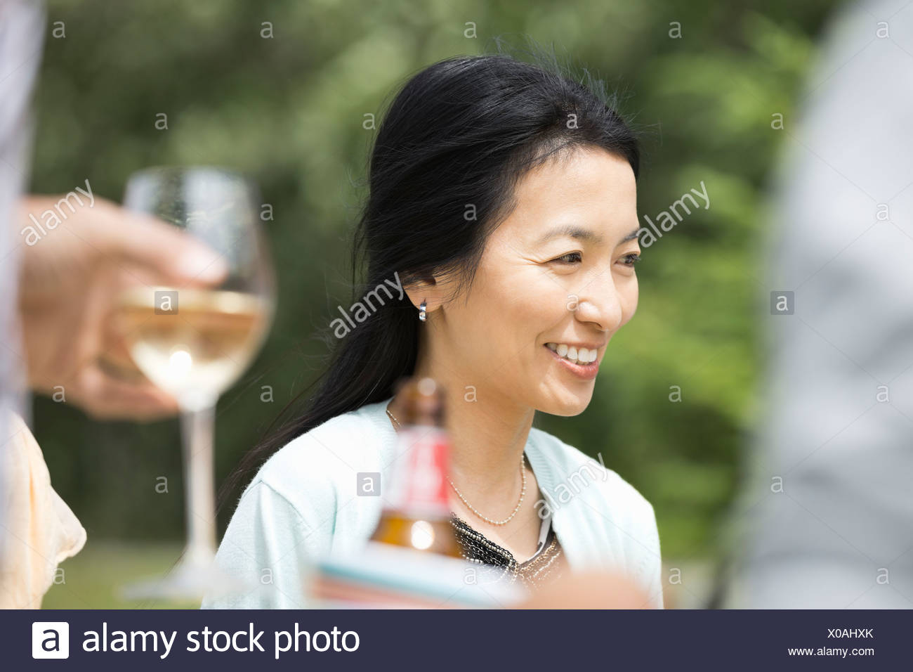 Mature woman smiling outdoors - Stock Image