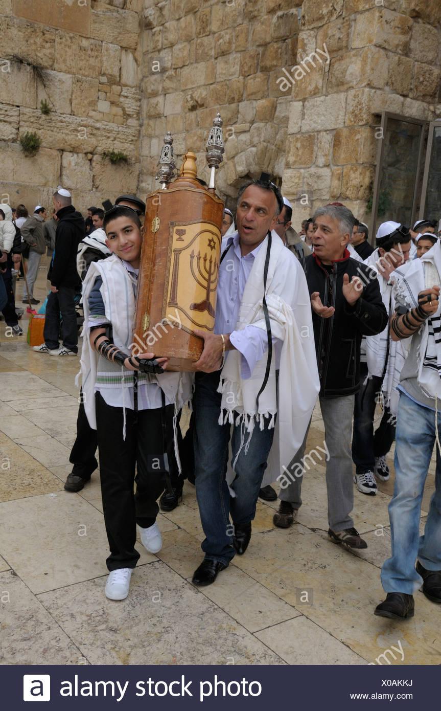 Orthodox Jews carrying a Torah scroll, Jerusalem, Israel, Middle East - Stock Image