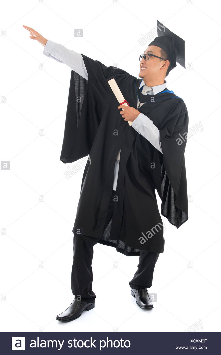Full length happy pan Asian university student in graduation gown ...