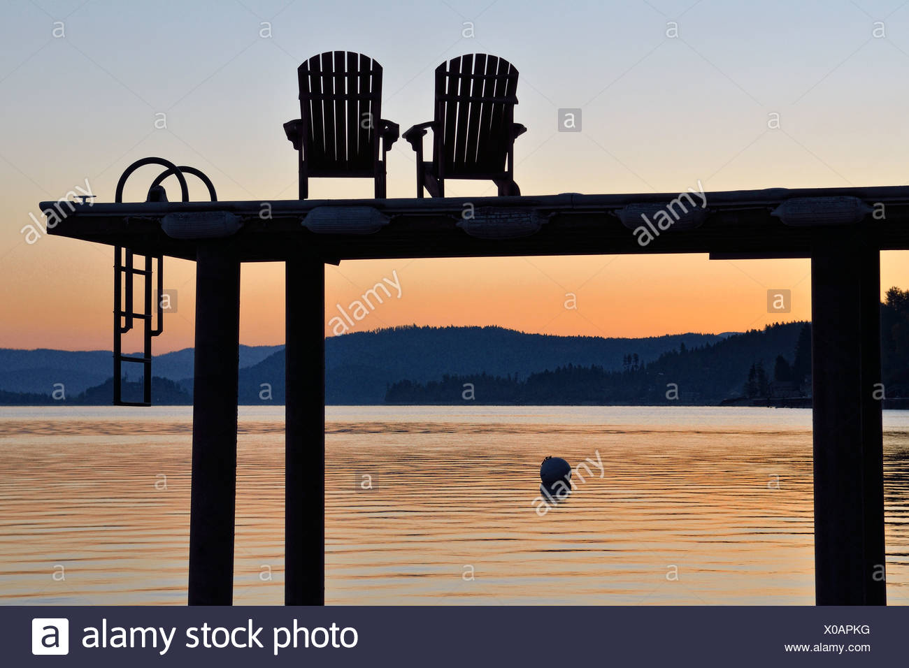 Jetty with chairs, Lake Pend Oreille, Sandpoint, Idaho, USA - Stock Image