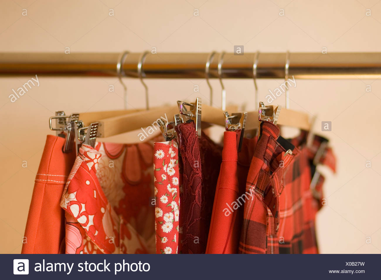 Skirts hanging on clothes rack - Stock Image