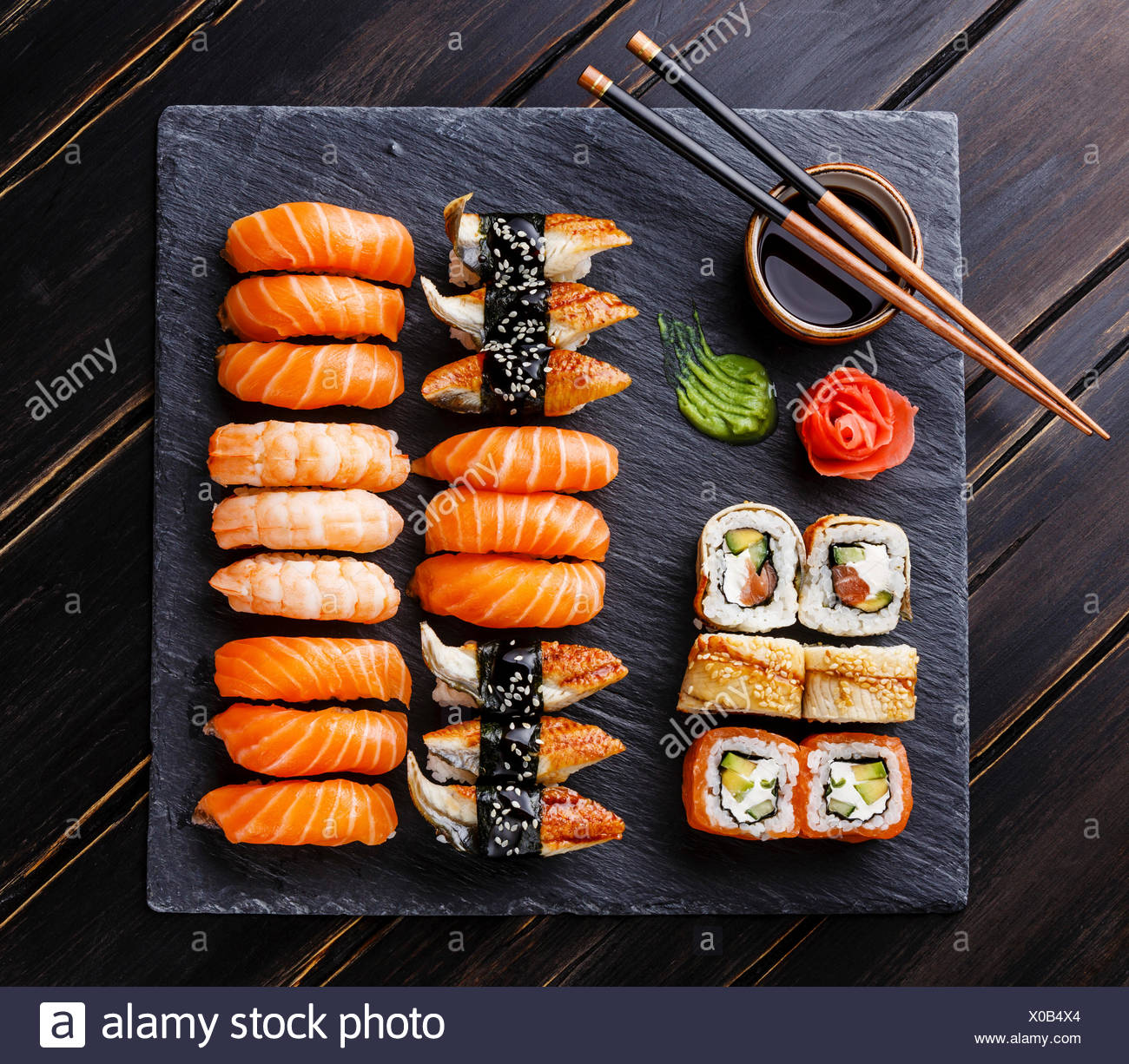 Sushi Set on black stone slate background - Stock Image