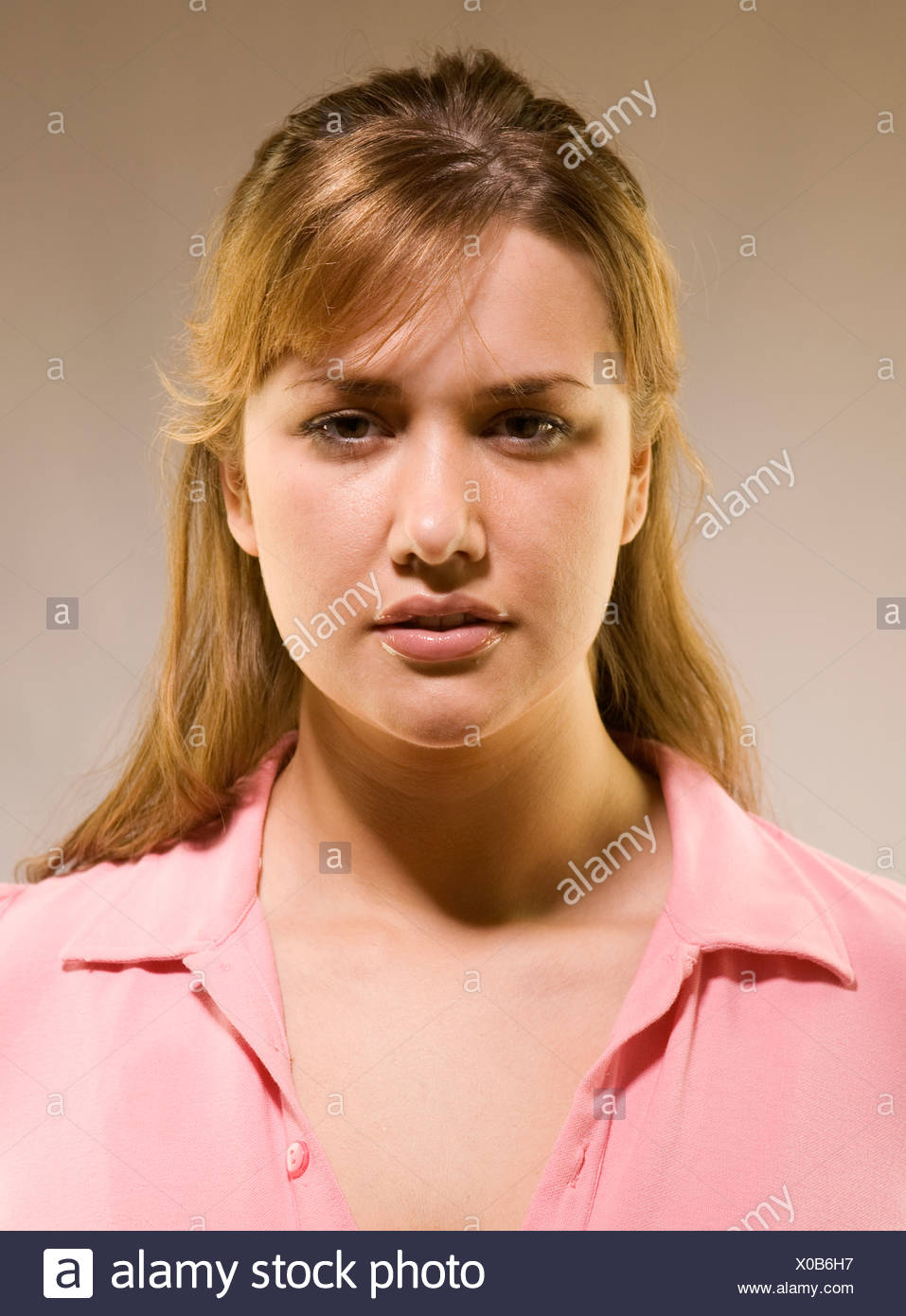 Portrait of woman with serious and concerned expression - Stock Image