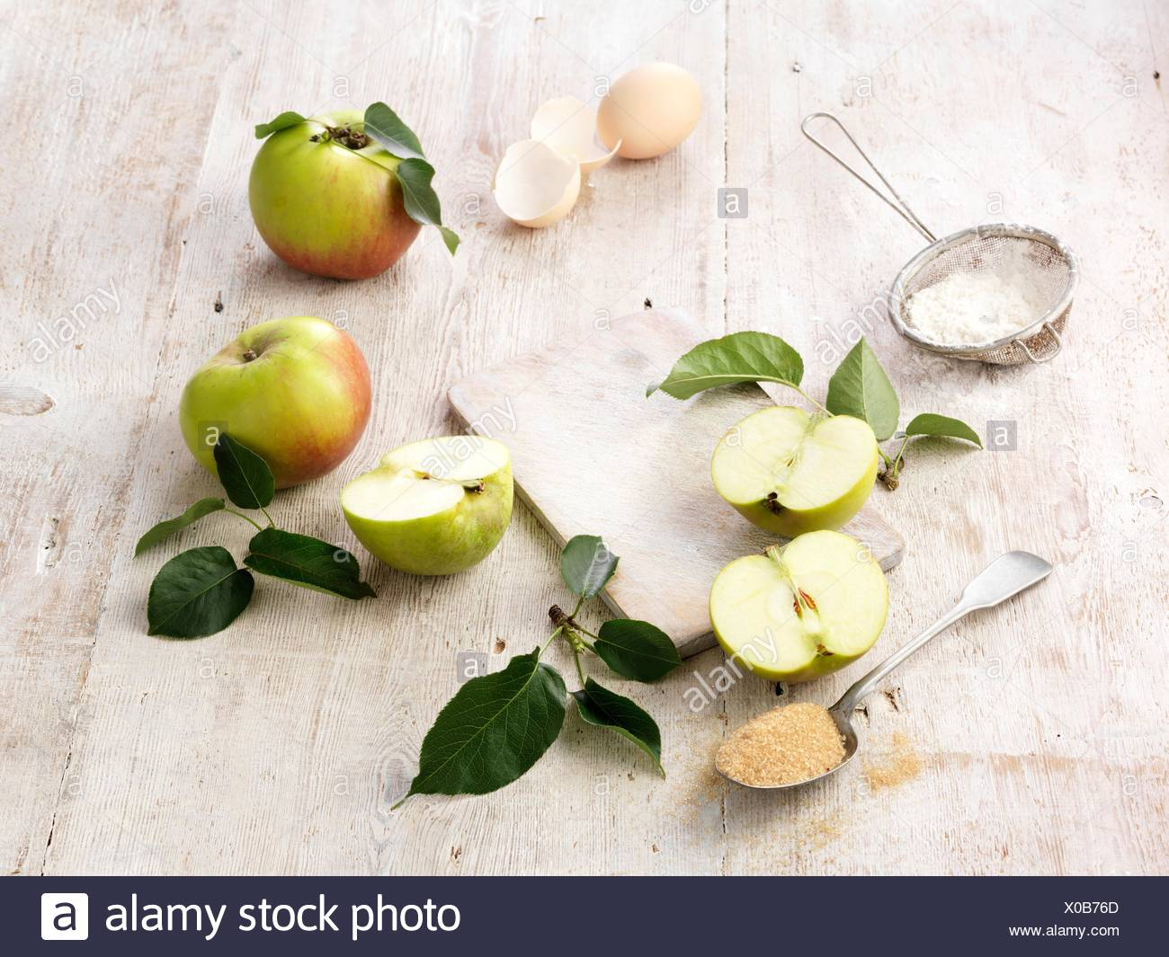 Ingredients for eve's pudding on whitewashed wooden table - Stock Image