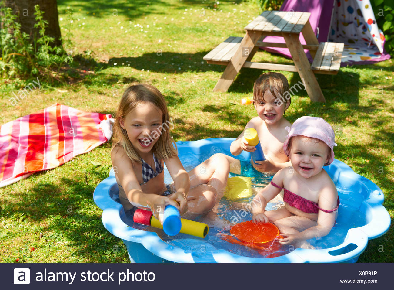 Children playing in wading pool - Stock Image