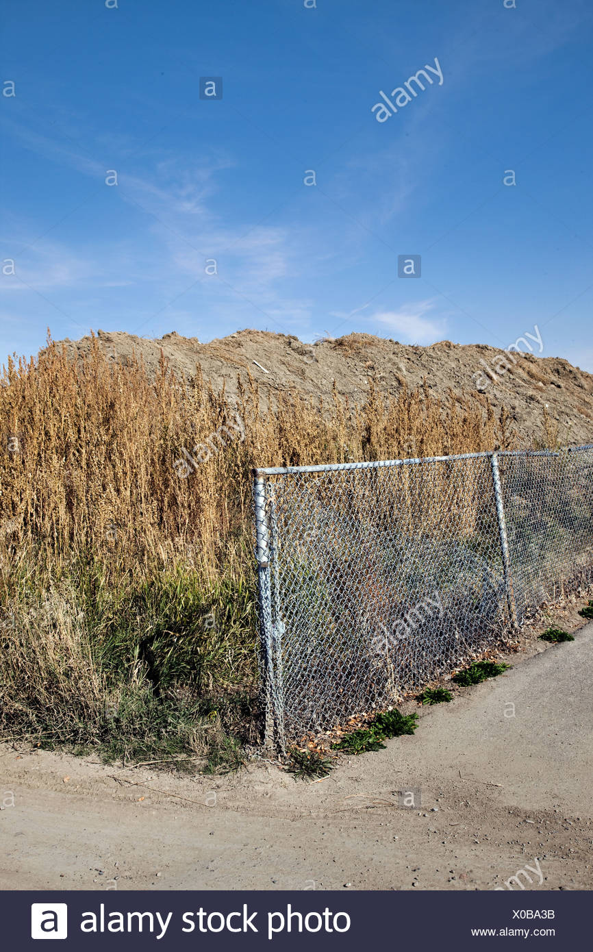 Fence next to a field Stock Photo