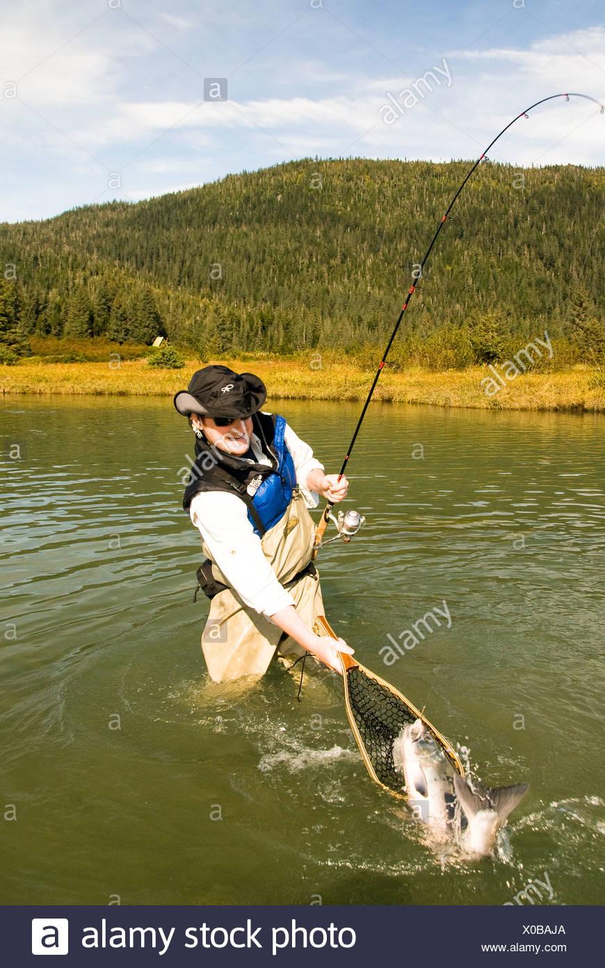United States, Alaska, Coghill Lake, fisherman catching a Silver (Coho) Salmon - Stock Image