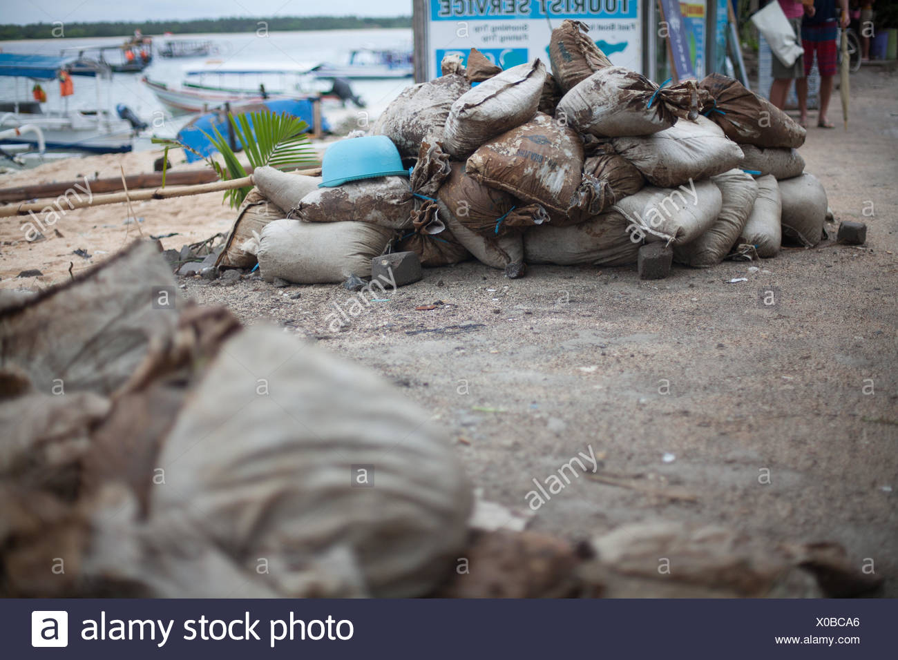 Heap Of Sacks On Sand At Beach - Stock Image