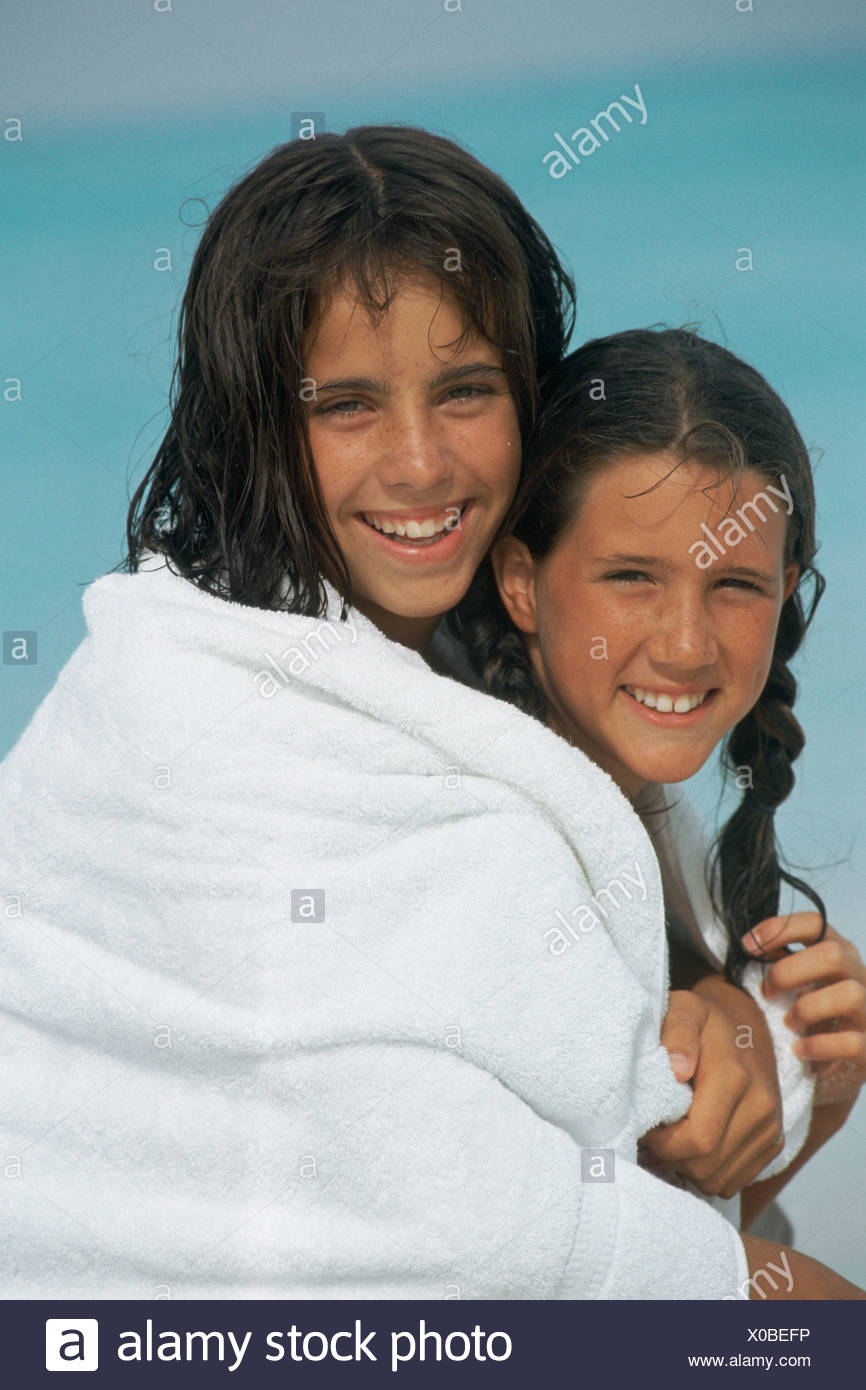 Portrait 2 Little Girls Posing Smiling Embracing In White Towel