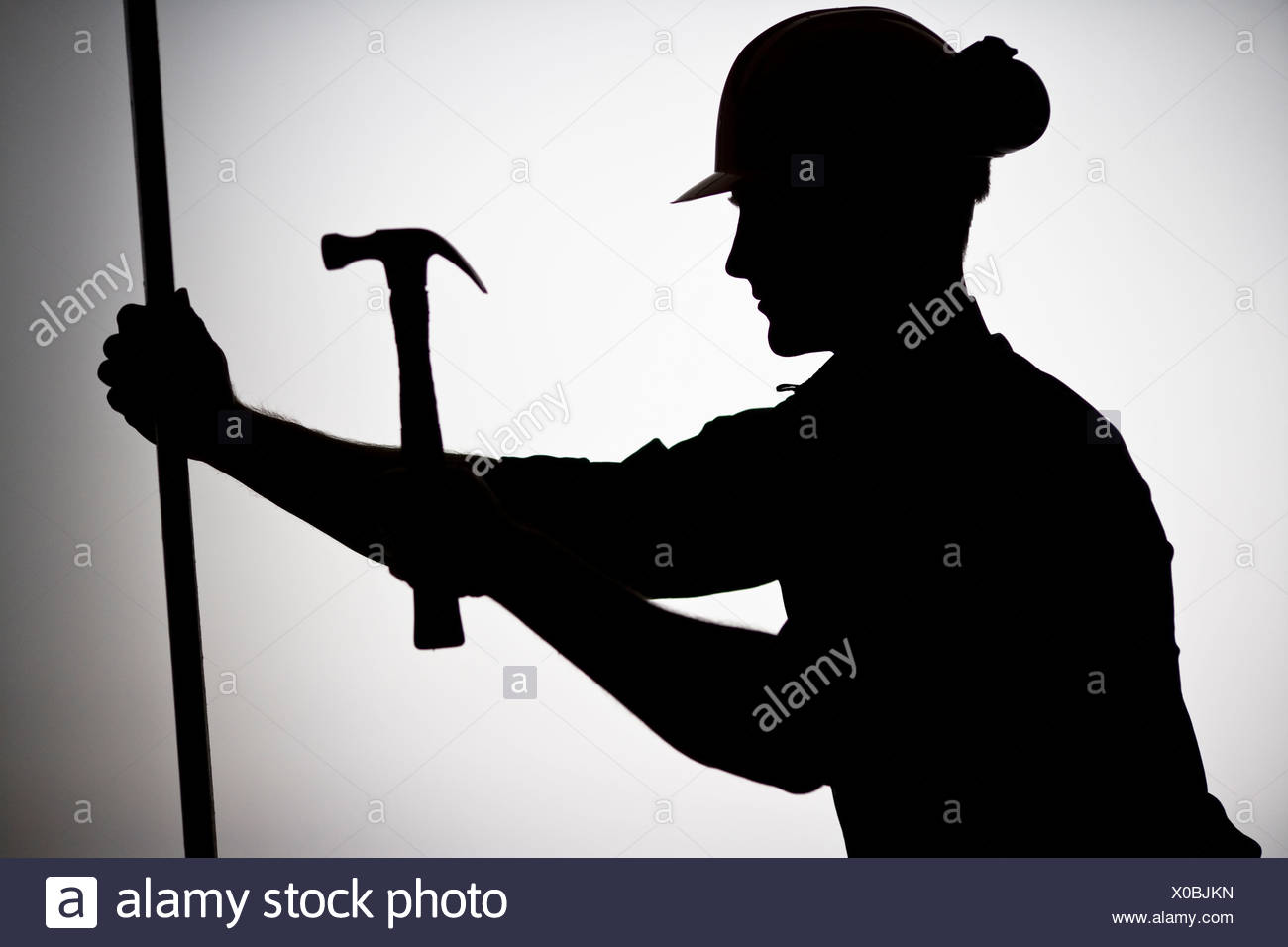A construction worker using a hammer. Stock Photo