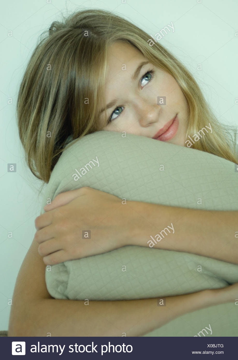 Young woman holding blanket - Stock Image