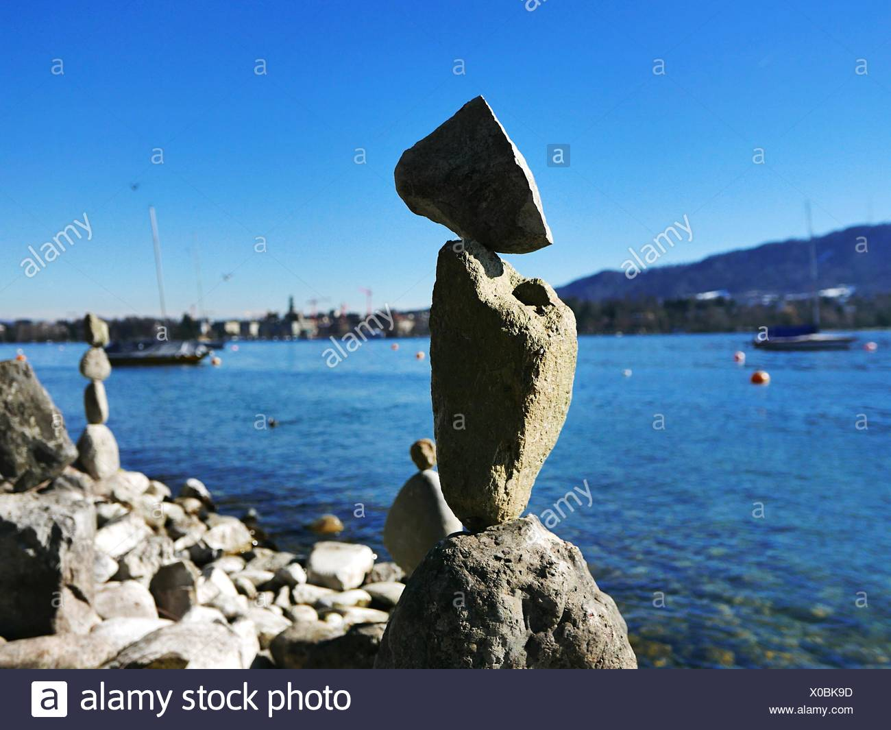 Close-Up Of Stone Pile With Sea In Background Stock Photo