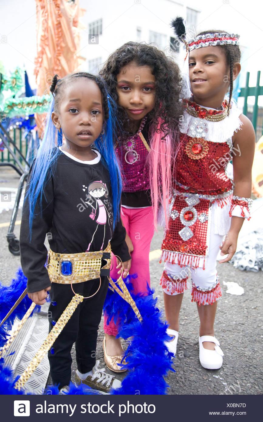 Children in carnival costume. Three little girls. Notting Hill Carnival, Notting Hill. London. England. UK. - Stock Image