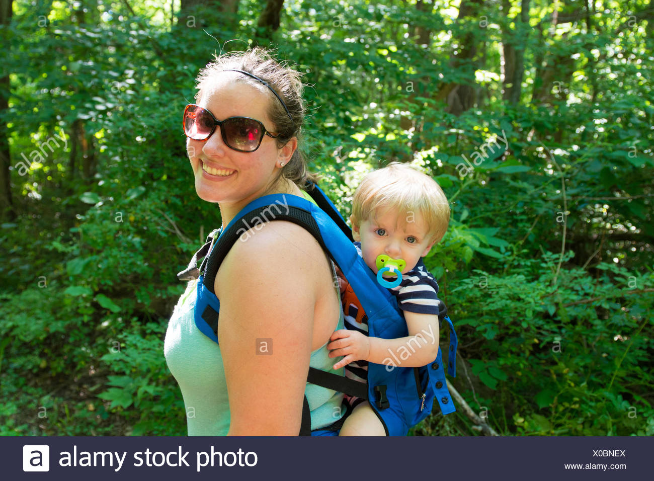 USA, Indiana, Mother and son hiking in woods Stock Photo
