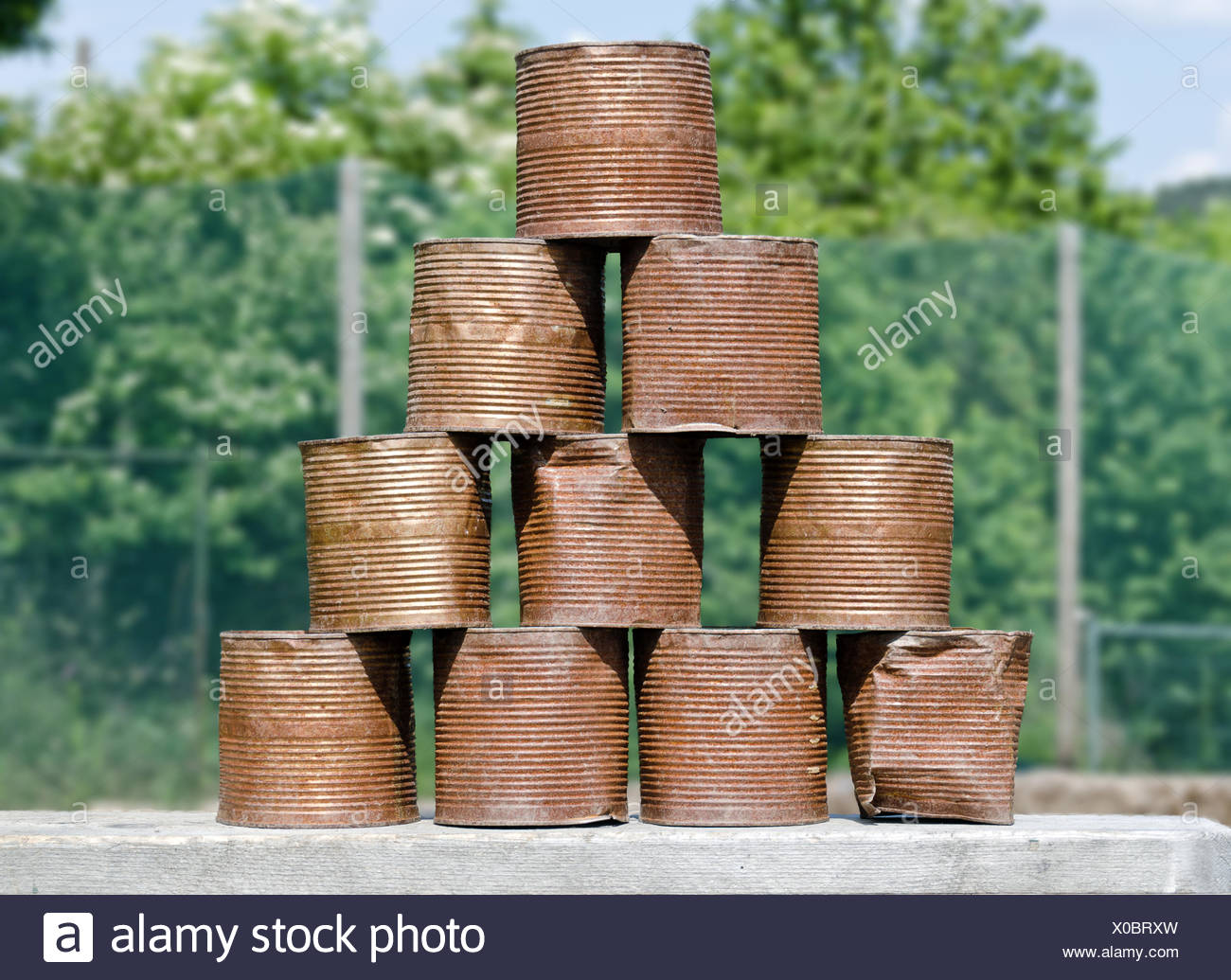 stack of rusty tins - Stock Image