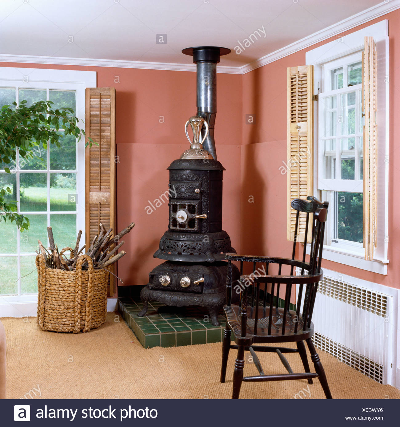 Large Black Stove In The Corner Of Pink Livingroom With