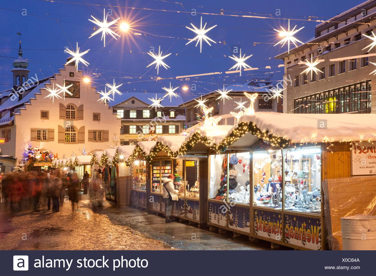 Switzerland Europe night dark Christmas Advent canton SG St. Gallen St. Gall market Christmas fair evening lights winter - Stock Image