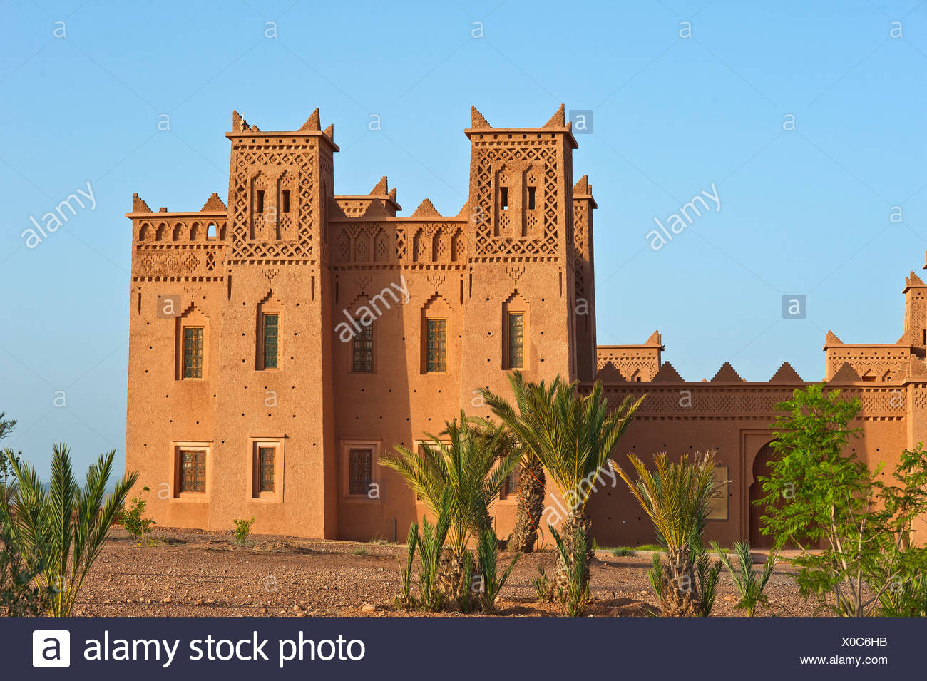 Newly built Kasbah, built of rammed earth, Tighremt or stronghold of the Berber, Ouarzazate, Lower Dades Valley, Kasbah Road - Stock Image
