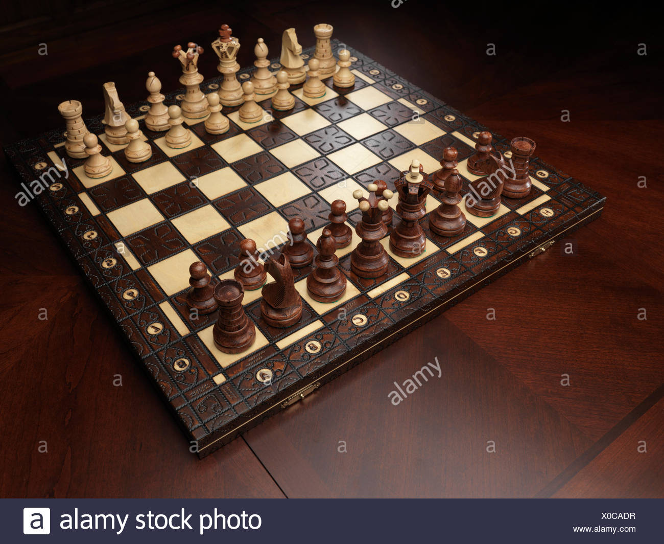 Chessboard on a table - Stock Image