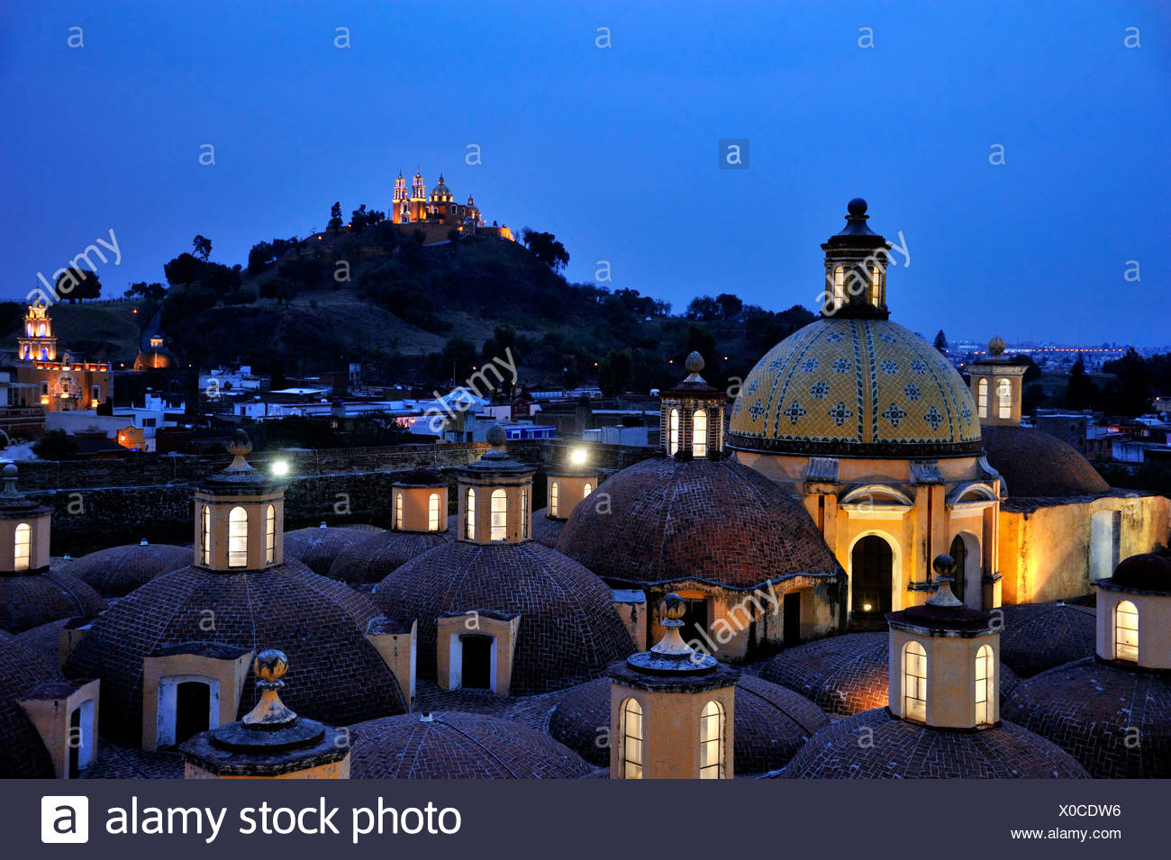 Roof of the Convento de San Gabriel monastery at night in front of the church of Iglesia Nuestra Senora de los Remedios on the Stock Photo