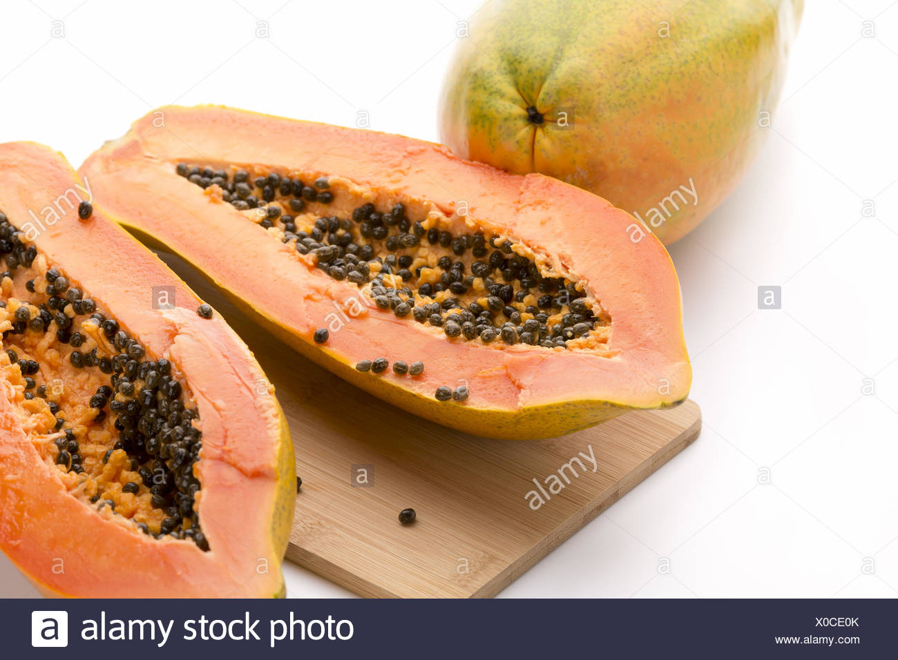 Papaya Halved With A Longitudinal Cut - Stock Image