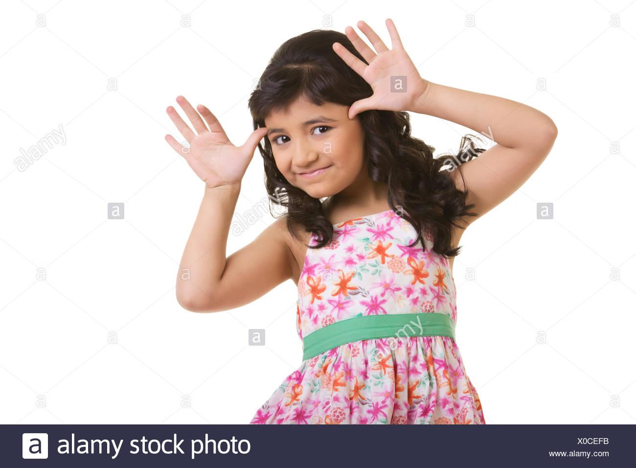 Girl making a teasing face - Stock Image
