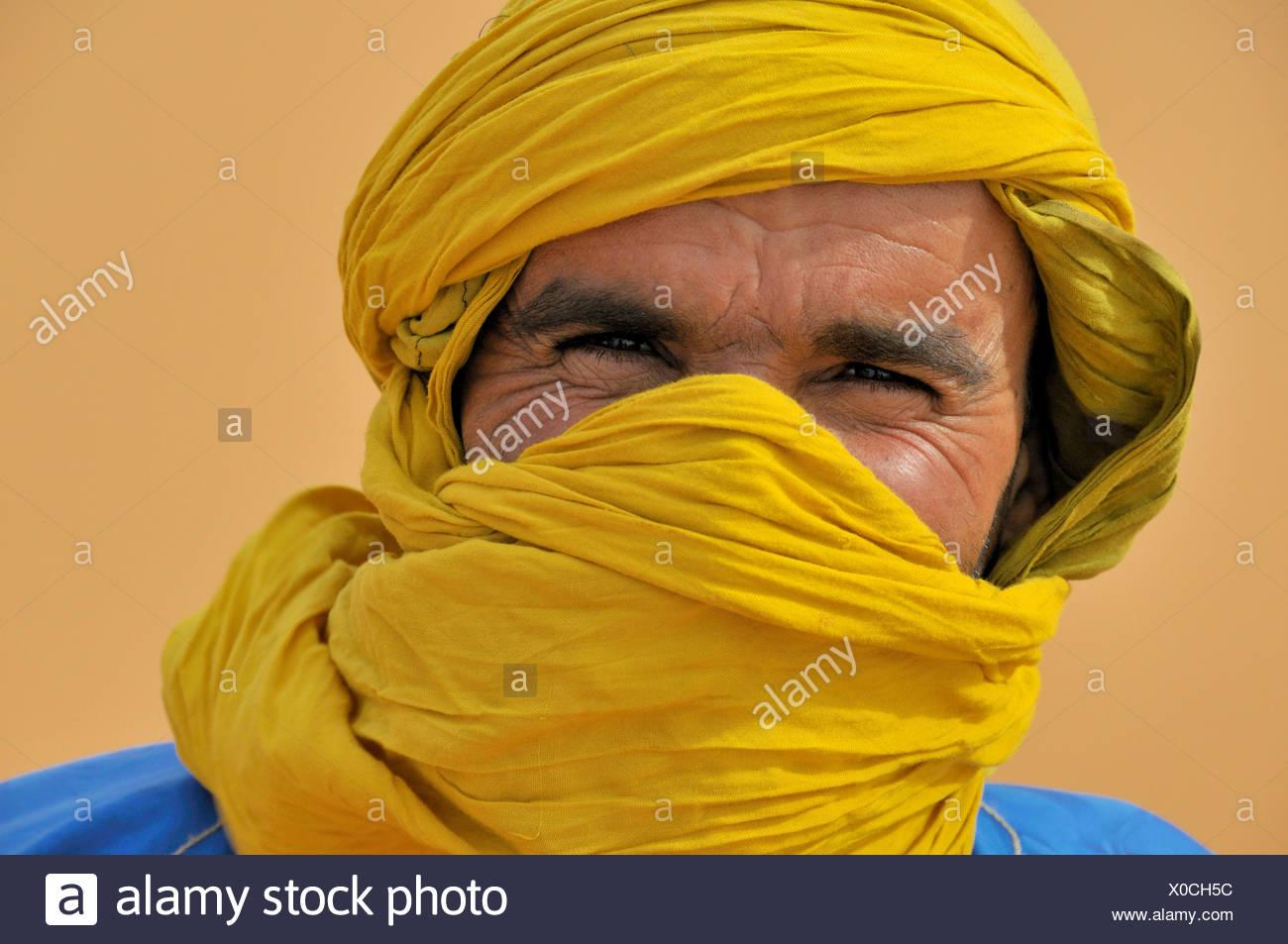berber with traditional tagelmust, portrait, Morocco, Erg Chebbi, Sahara Stock Photo