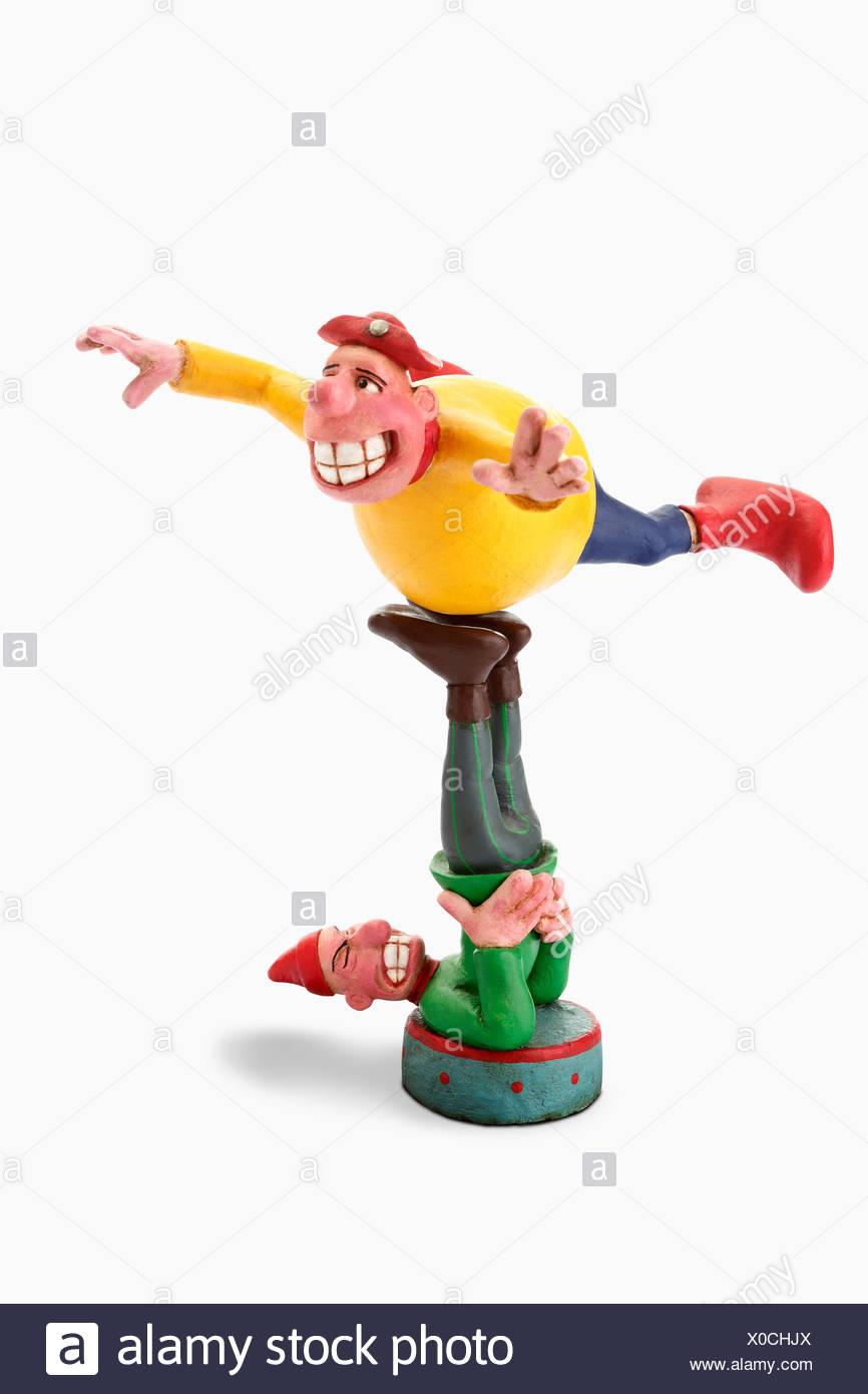 Fools or gymnasts, cartoon characters - Stock Image