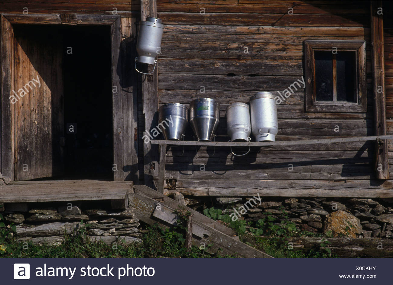 Milk cans in wooden house, Bichlalm, Tux Valley, Tyrol, Austria - Stock Image