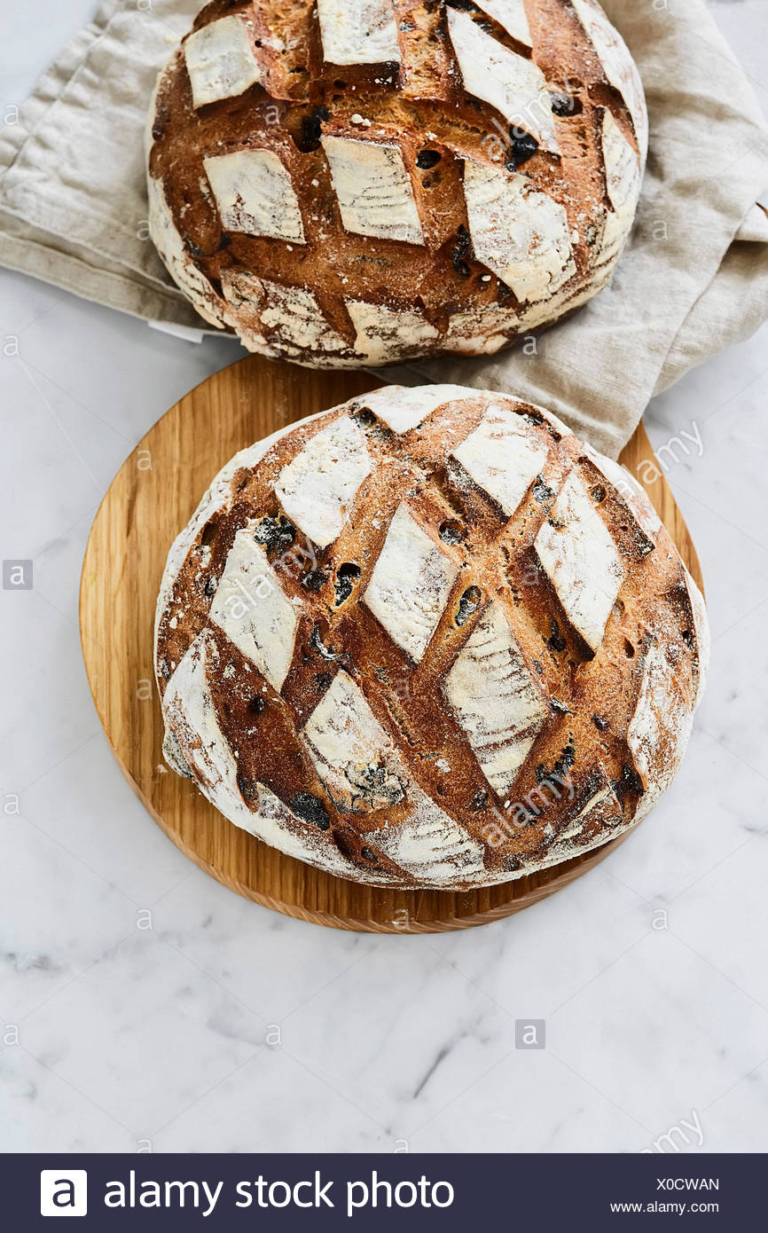 Loaves of bread with prunes. Wheat bread. - Stock Image