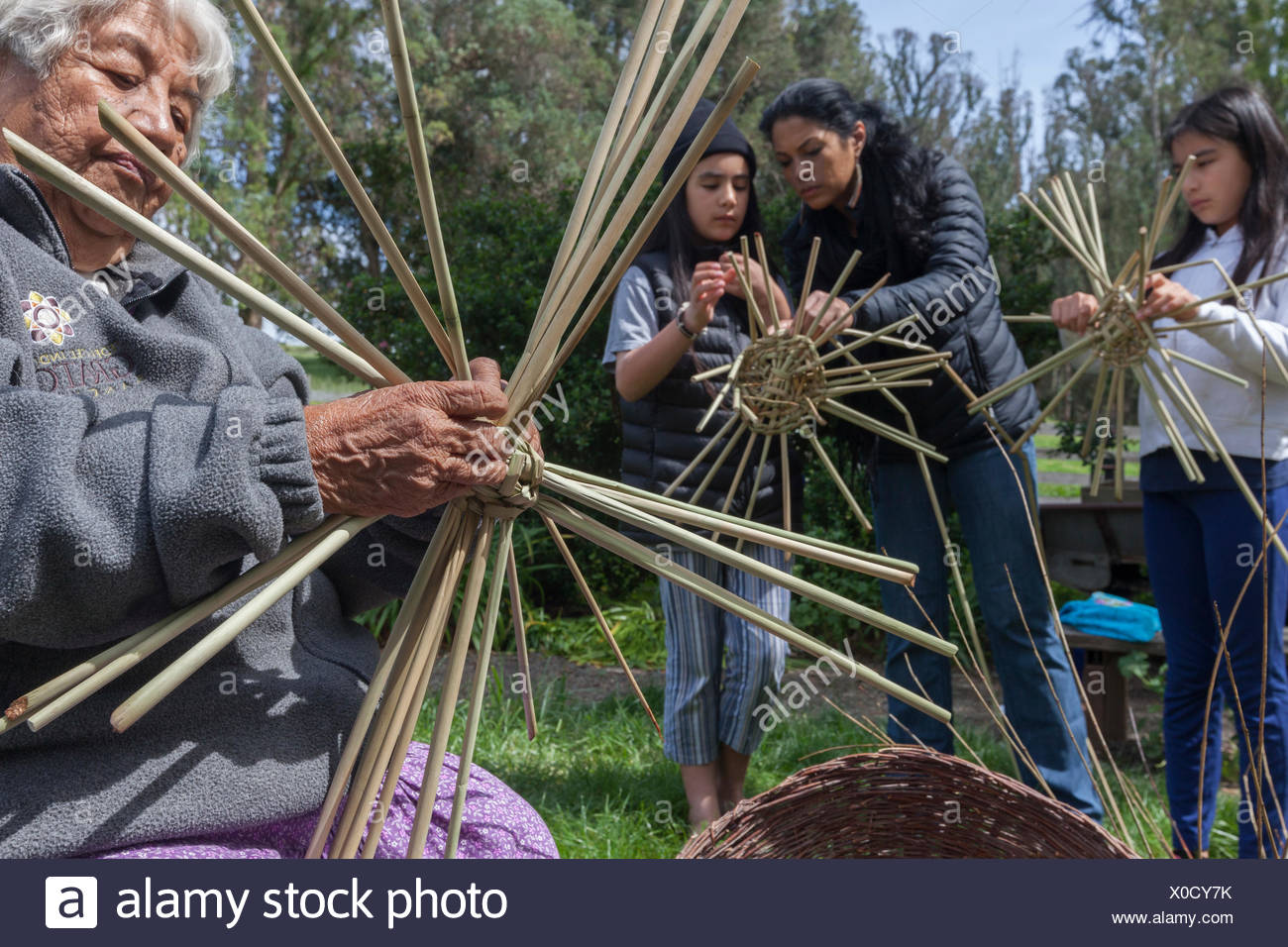 Native American Weavers from Federated Nations of Graton Rancheria (Souther Pomo and Coastal Miamok and other tribes from the Golden Gate to the Russian River at a gathering at Tolay Lake,CA - Stock Image