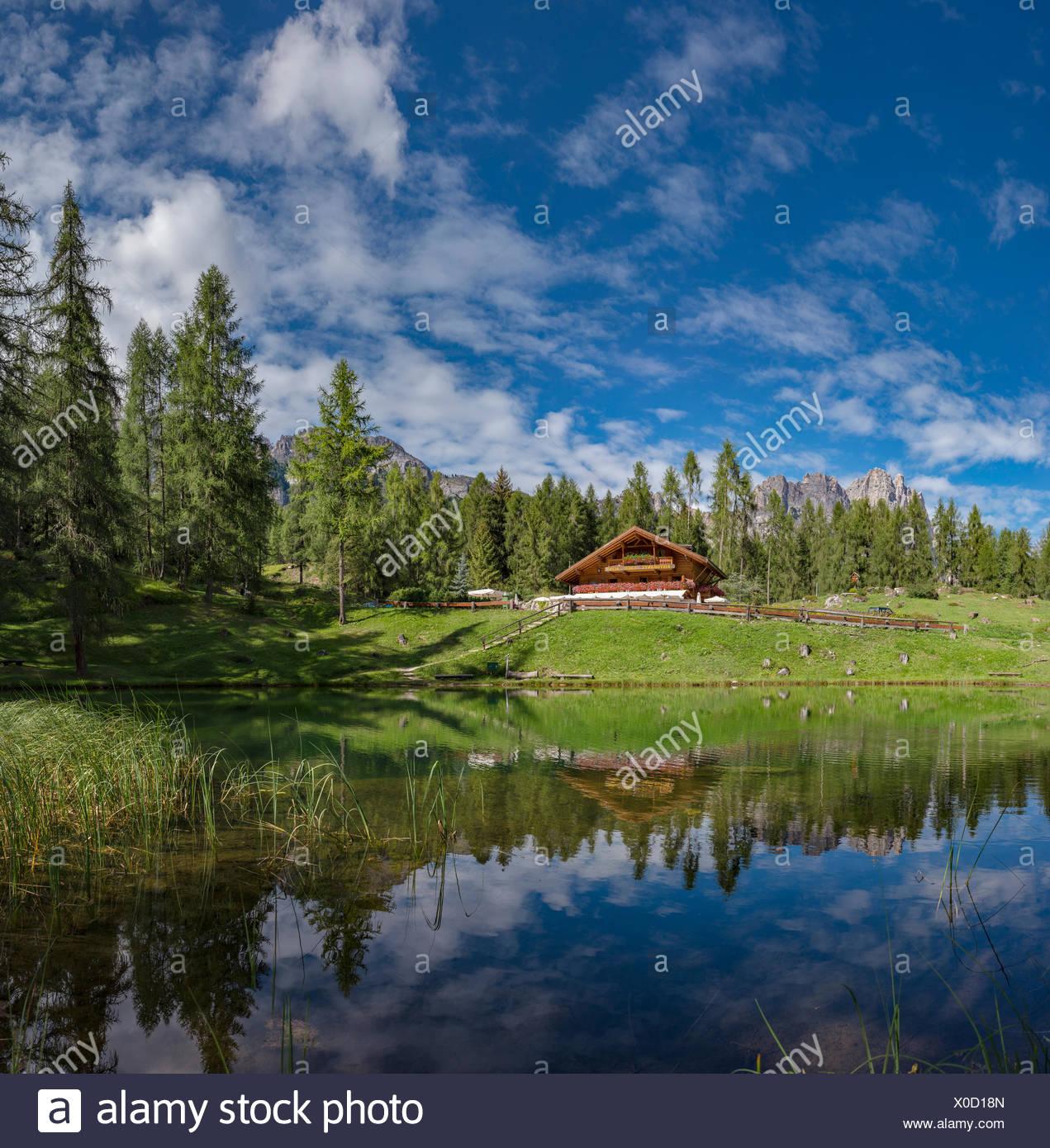 Cortina d'Ampezzo,Italia,Restaurant reflected in Lago Scin - Stock Image