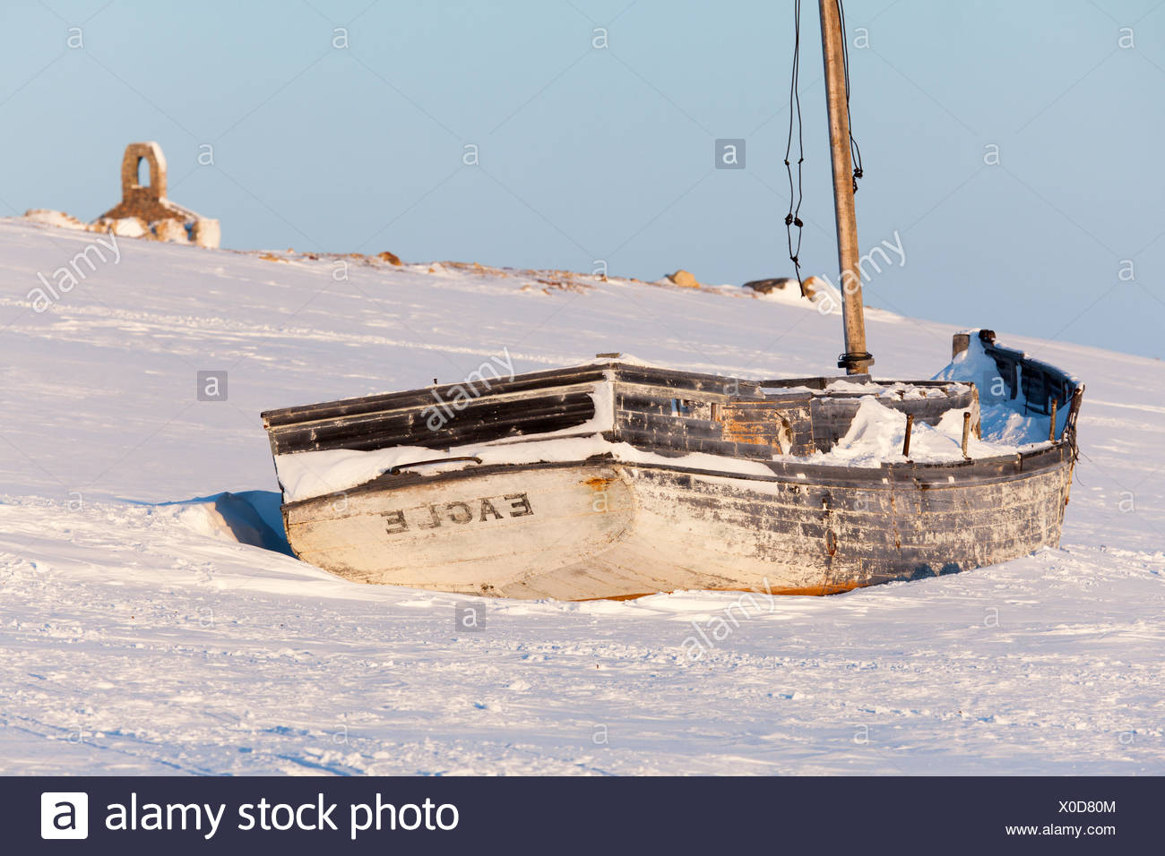 A boat sits on the shores of Cambridge Bay, Nunavut, Canada Stock Photo
