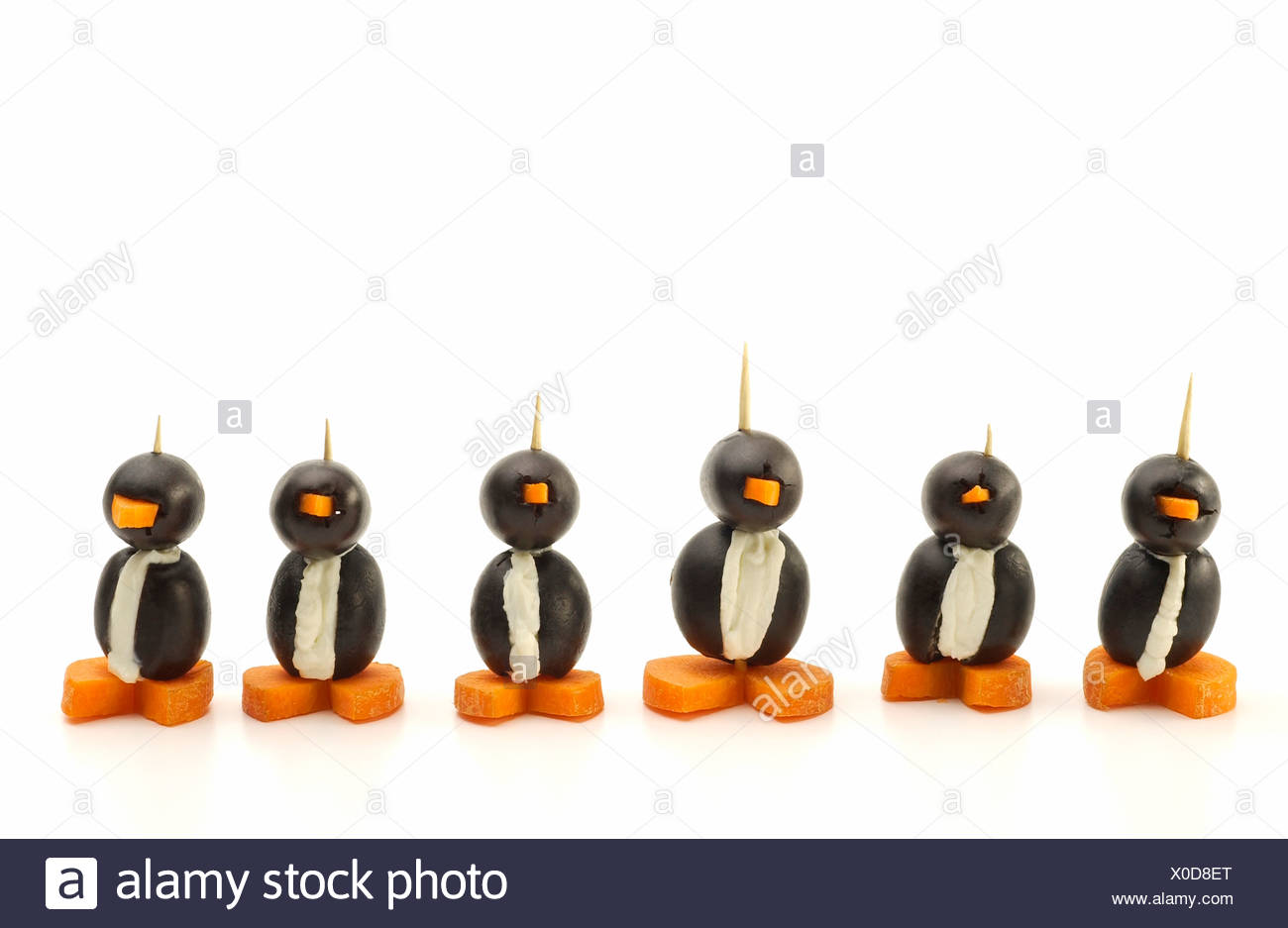 Penguins made of olives, cream cheese and carrots; Appetizers - Stock Image