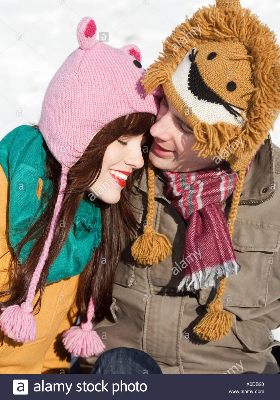 Orem, Utah, USA, boyfriend and girlfriend wearing funny knit hats, embracing - Stock Image
