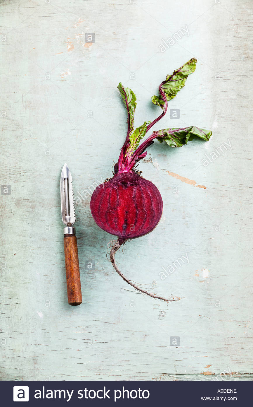 Ripe beetroot with leaves on textured background - Stock Image