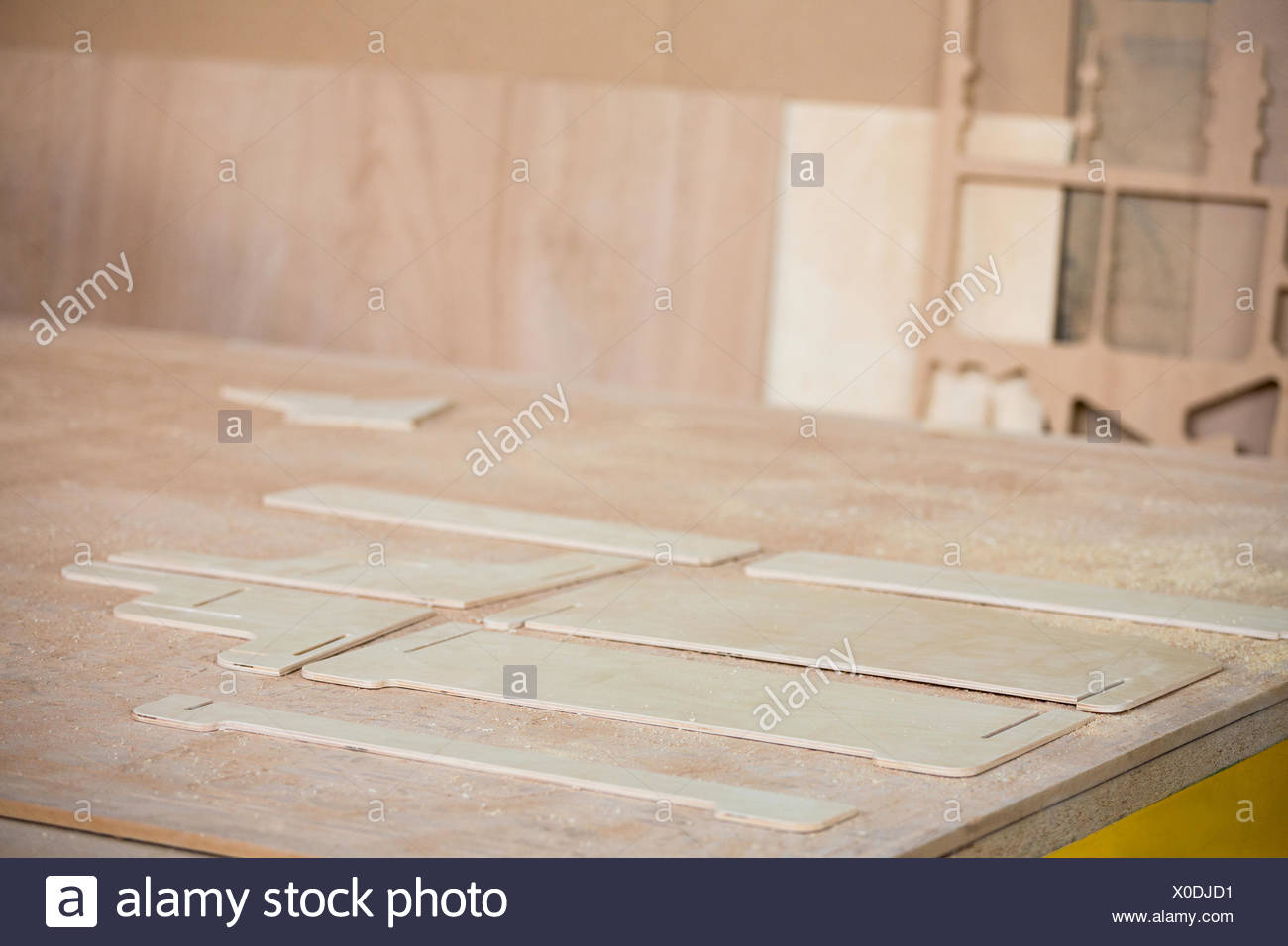 Sawing plank of wood - Stock Image